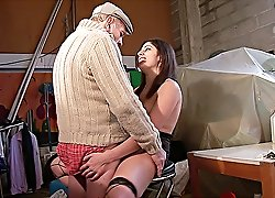 Hot chick in high-heel shoes spreads her legs on a table and gets her tight pussy fucked good by two older men