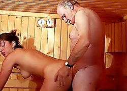 Depraved older men join beautiful chick in a sauna steam room and give her a jaw-dropping triple gangbang