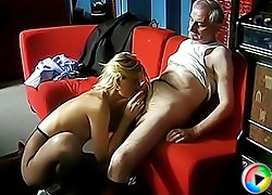 Hot chick in sexy fishnet pantyhose giving old man a killer blowjob and riding his hairy cock in various positions