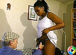 Hot ebony chick in sexy white stockings giving head to a horny old grandpa and begging him for a mouthful of cum